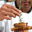 Stock Photo: Professional chef garnish meat dish