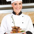 Female chef presenting food — Stock Photo #10674546