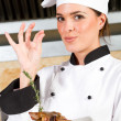 Female chef with delicious hand sign — Stock Photo