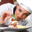 Chef decorating dessert — Stock Photo