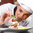 Foto de Stock  : Chef decorating dessert