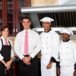 Restaurant staff inside industrial kitchen — Foto de Stock
