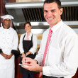 Young happy male restaurant manager — Stock Photo