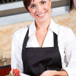 Female waitress presenting plate of dessert — Stock Photo