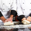 Professional chef hands kneading bread dough on kitchen counter — Stok fotoğraf