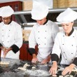 Chefs baking in kitchen - Stock Photo
