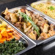 Stock Photo: Buffet style food in trays