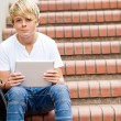 Teen boy using tablet computer — Stock Photo