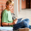 High school teen student using tablet computer - Stock Photo