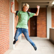 Happy high school student jumping up — ストック写真