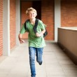 Middle school student running in school passage — Stock Photo #10676321
