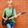Royalty-Free Stock Photo: Teen boy playing guitar