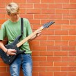 Teen boy playing guitar — ストック写真