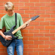 Teen boy playing guitar — Stock Photo