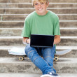 Teen boy with laptop — Stock Photo