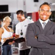 Smiling gym manager - Stock Photo