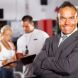 Confident gym manager - Stock Photo