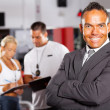 Confident gym manager — Stock Photo