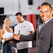 Gym manager welcome customer — Stock Photo