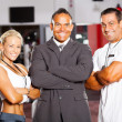 Stock Photo: Gym manager and trainers
