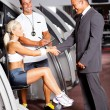 Gym manager greeting customer — Stock Photo #10678211