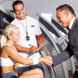 Stock Photo: Gym manager greeting customer