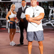 Stock Photo: Trainer and gym colleague