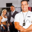 Muscular gym trainer — Stock Photo