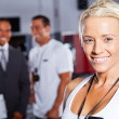 Stock Photo: Pretty female gym trainer