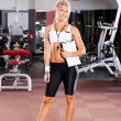 Young female gym instructor — Stock Photo #10678450