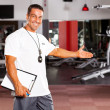 Постер, плакат: Gym trainer welcome customer