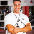 Stock Photo: Professional gym instructor