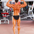Bodybuilder rear view — Stock Photo