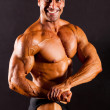 Bodybuilder on black background — Stock Photo #10679006