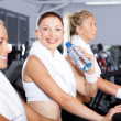 Woman drinking water in gym — Stock Photo