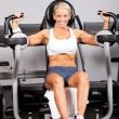 Stock Photo: Fitness womusing peck deck machine