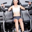 Fitness woman exercising with peck deck machine - Stock Photo