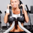 Stock Photo: Young womworking out in gym