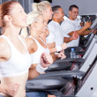 Foto Stock: Group of exercising with treadmill
