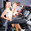 Stock Photo: Group of running on treadmill