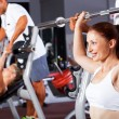 Fitness woman with personal trainer — Stock Photo