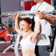 Stock Photo: Fitness woman with personal trainer