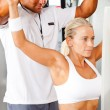 Fitness woman and personal trainer — Stock Photo