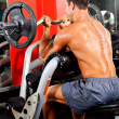 Man working out with barbell — Stock Photo