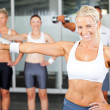 Foto Stock: Group of exercise in gym