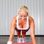 Fitness woman doing push ups — Stock Photo #10679653