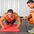 Fitness man and personal trainer in gym — Stock Photo