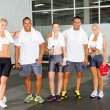 Group of relaxing in gym after workout - Stock Photo