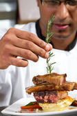 Professional chef garnish meat dish — Stock Photo