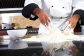 Professional chef making dough — Stock Photo